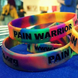 Pain Warrior Bracelet - Chronic pain comes in many shades. The descriptions alone can be colorful: throbbing, shooting, aching, burning, freezing, and so many more. Pain patients rarely describe their pain by using only one of these vivid explanations. Just as there are innumerable ways to describe pain, there are countless conditions that  can cause or contribute to chronic pain; each condition is represented by its own awareness ribbon color.Our rainbow of colors represents all the many different conditions that cause pain. The bracelet itself is a constant reminder that we are strong and that we are warriors in the fight against pain.