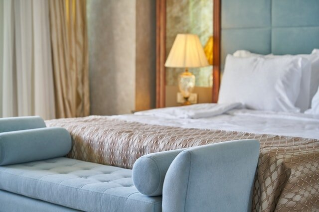 BIZ LOCATION modern traditional guest bedroom drapery light blue seat.jpg