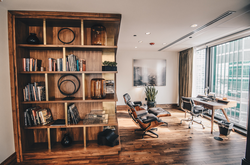old bookcase builtin home office eames chair overlooking city comfortable inviting inspiring.png
