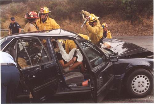 Photo:The Fire Dept. breaking Lynn out of her vehicle.