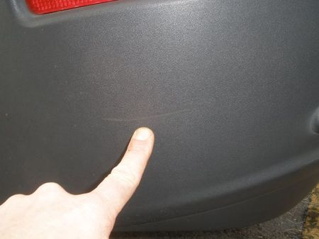 Photo: the best picture of vehicle damage in the case. Thank goodness the finger shows us where to look.
