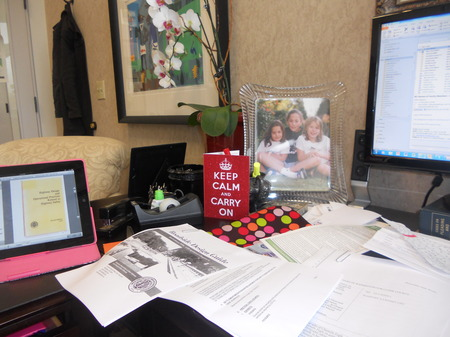 Photo: my desk centered with a card from Cristina