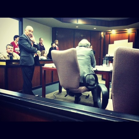 Photo: Taken during cross exam by a court observer. I am on the floor demonstrating how hard it is to put on and walk in a rigid leg brace. Notice how happy and engaged the jurors are. An unamused Nick is on the far left.