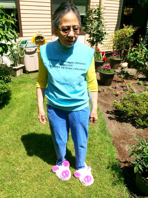 Photo: By Alysha - My melodramatic mother in her pink piggy slippers and slogan shirt.