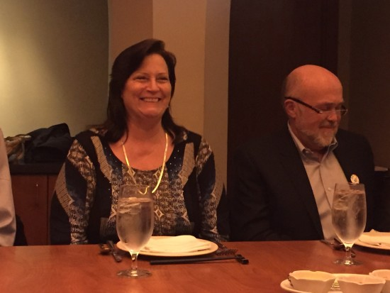 Photo:  Clare at her surprise 30th work anniversary luncheon next to Gerhard.