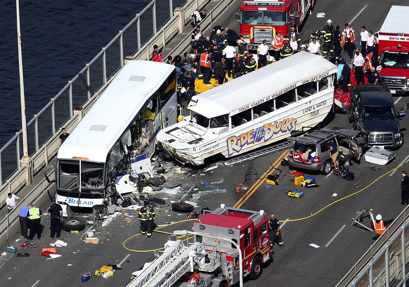 A Ride the Ducks vehicle collided with a charter bus on Seattle's Aurora Bridge, killing five students and injuring dozens of others. (Ken Lambert / The Seattle Times, 2015)