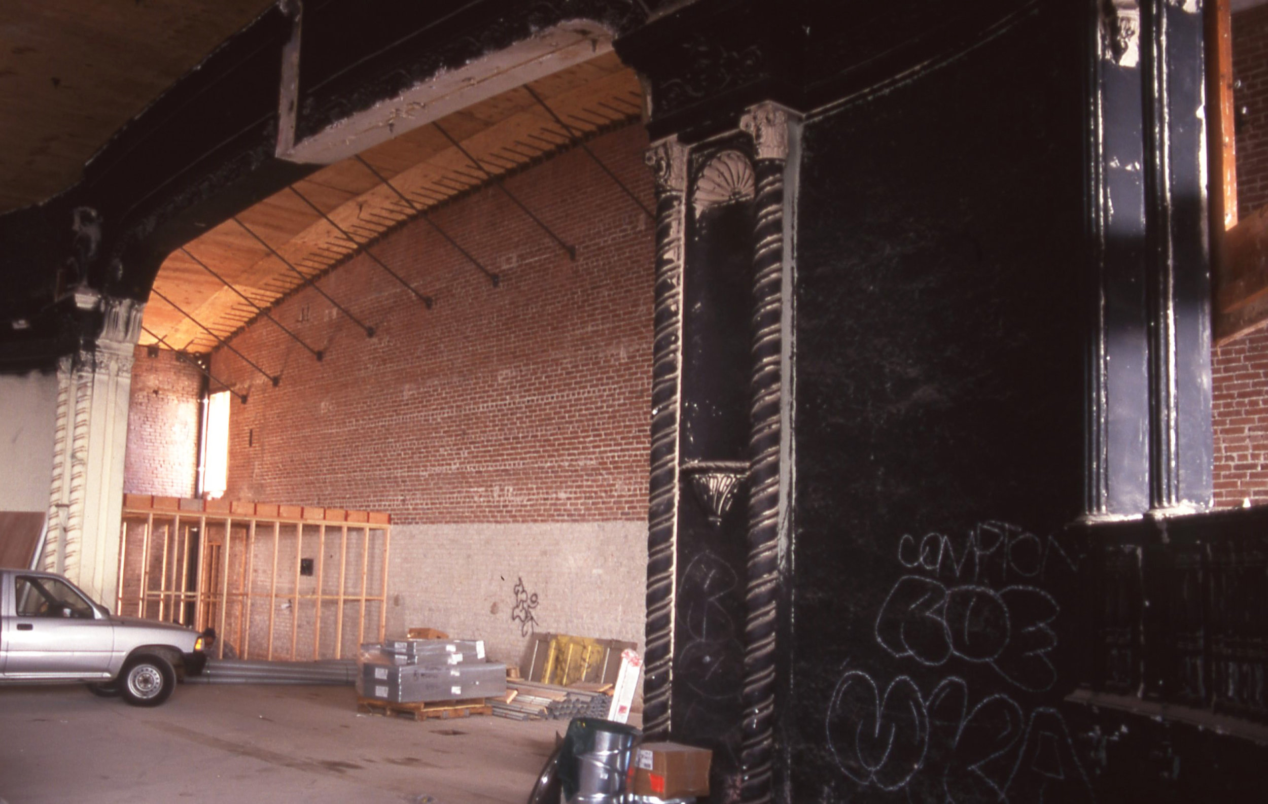 - View of the proscenium arch during the construction / renovation phase, The arch was painted black when the theater was converted into a cinema.