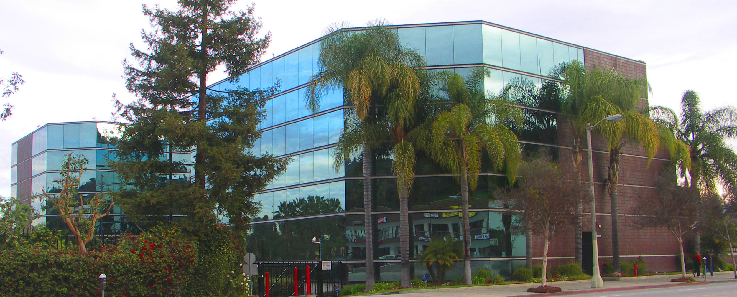 - A view showing the transition from ceramic tile to the reflective curtain wall along the Ventura Boulevard frontage.