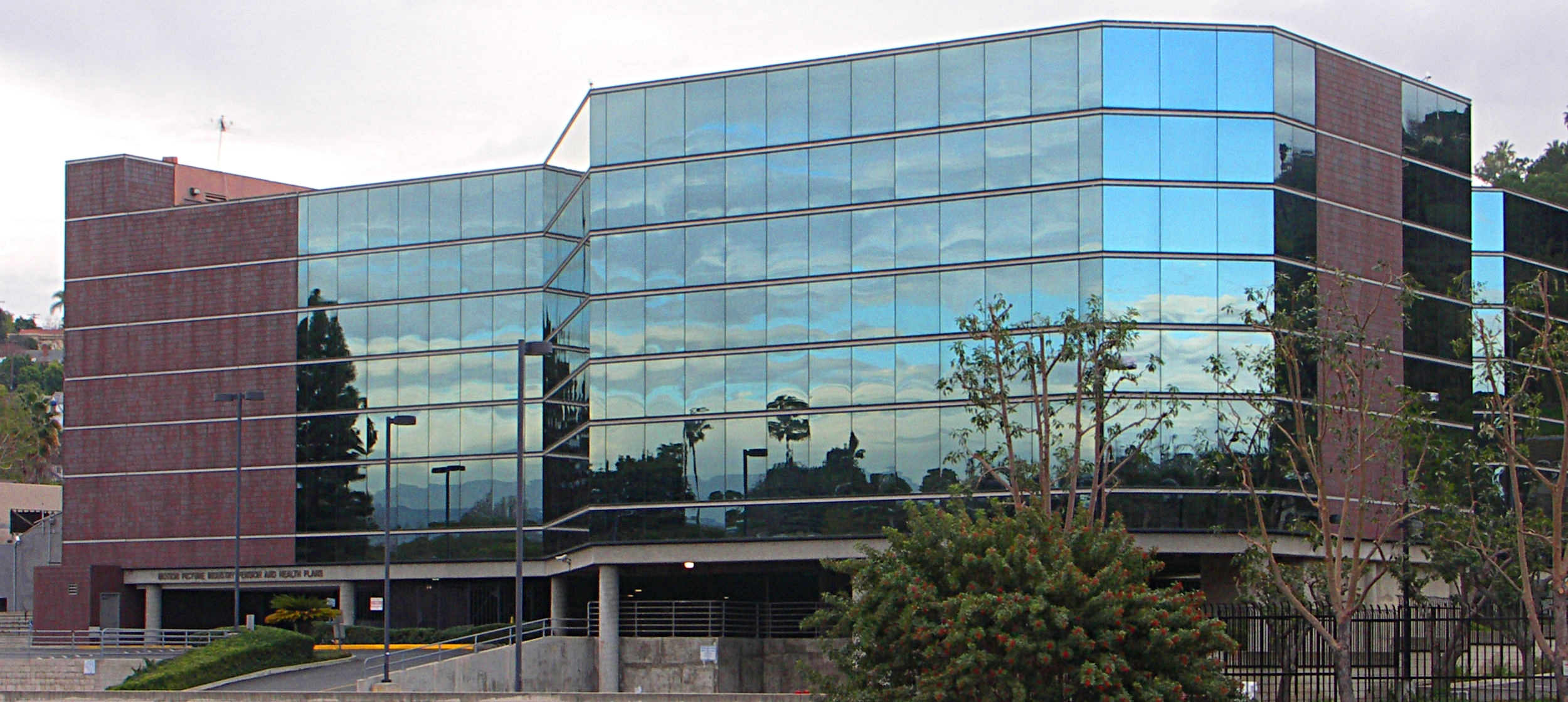 - The building's north side, which opens with the glass curtain wall system.