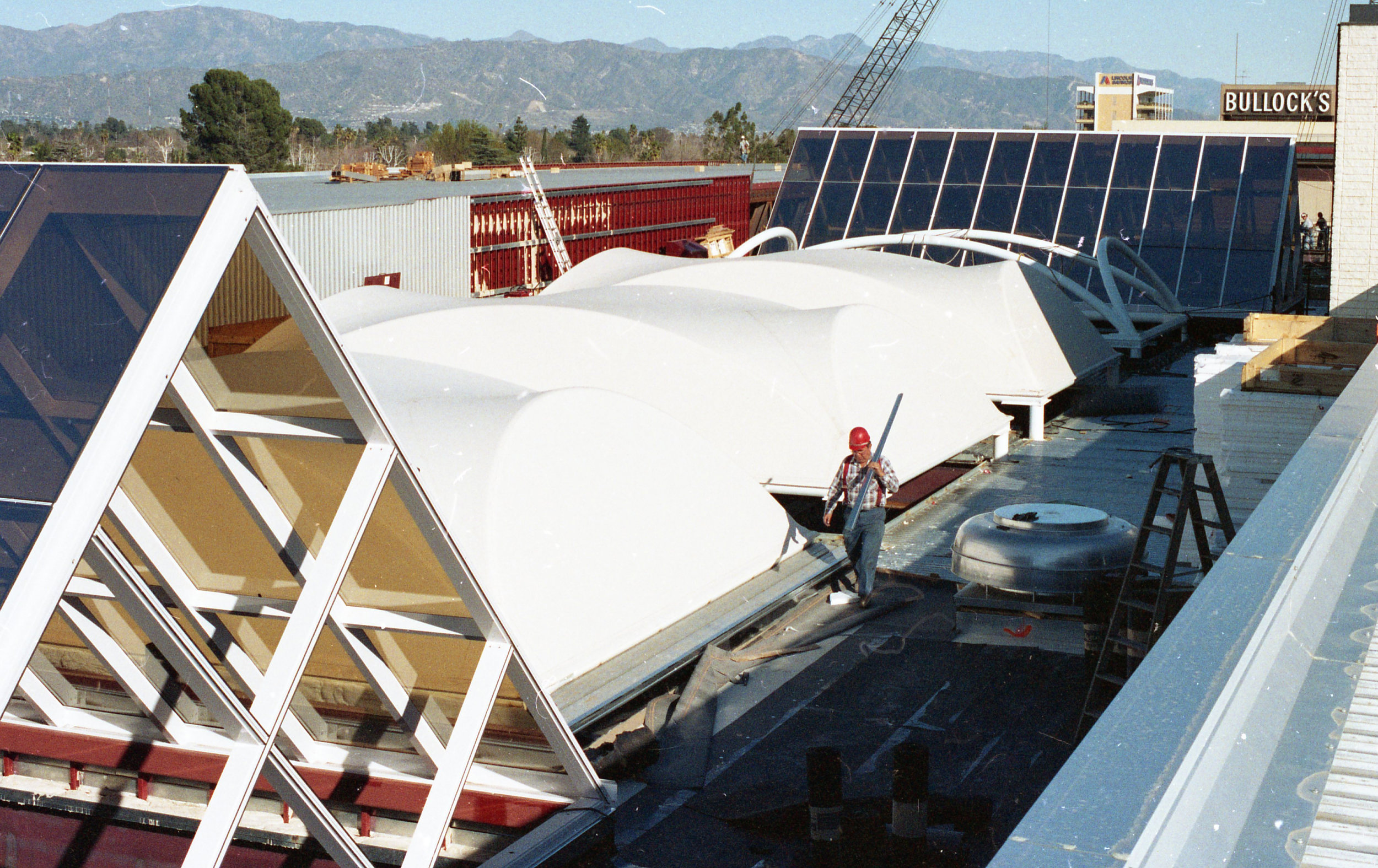 - A construction view showing the combination of fabric and glass skylights.
