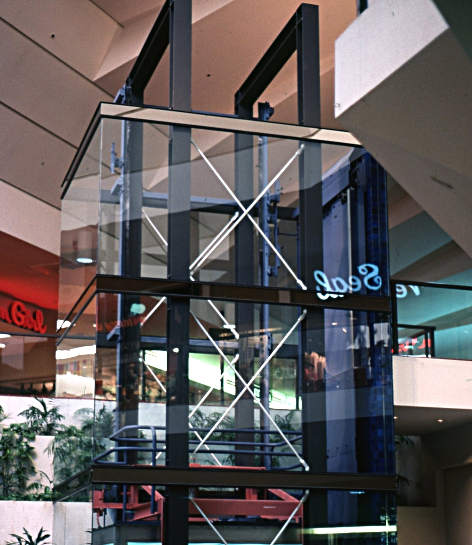 - As a part of the lower level development, two large court areas were added, connecting the upper and lower level malls.  One of the courts contained a glass enclosed elevator