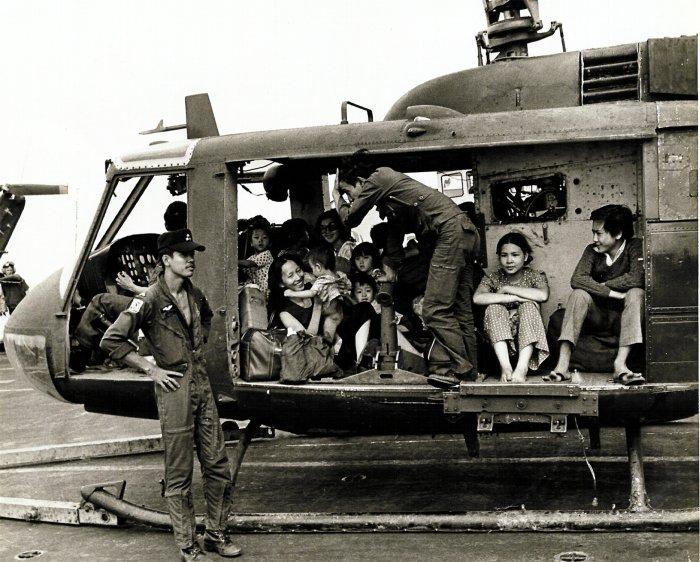 VNAF Huey full with evacuees.