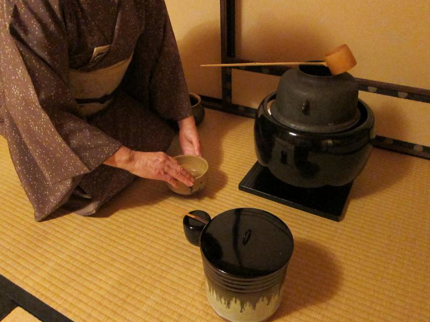 This photo provided by the Urasenke Chanoyu Center shows host Masako Soyu Miyahara purifying a tea whisk in front of guests at the institute in New York.jpg