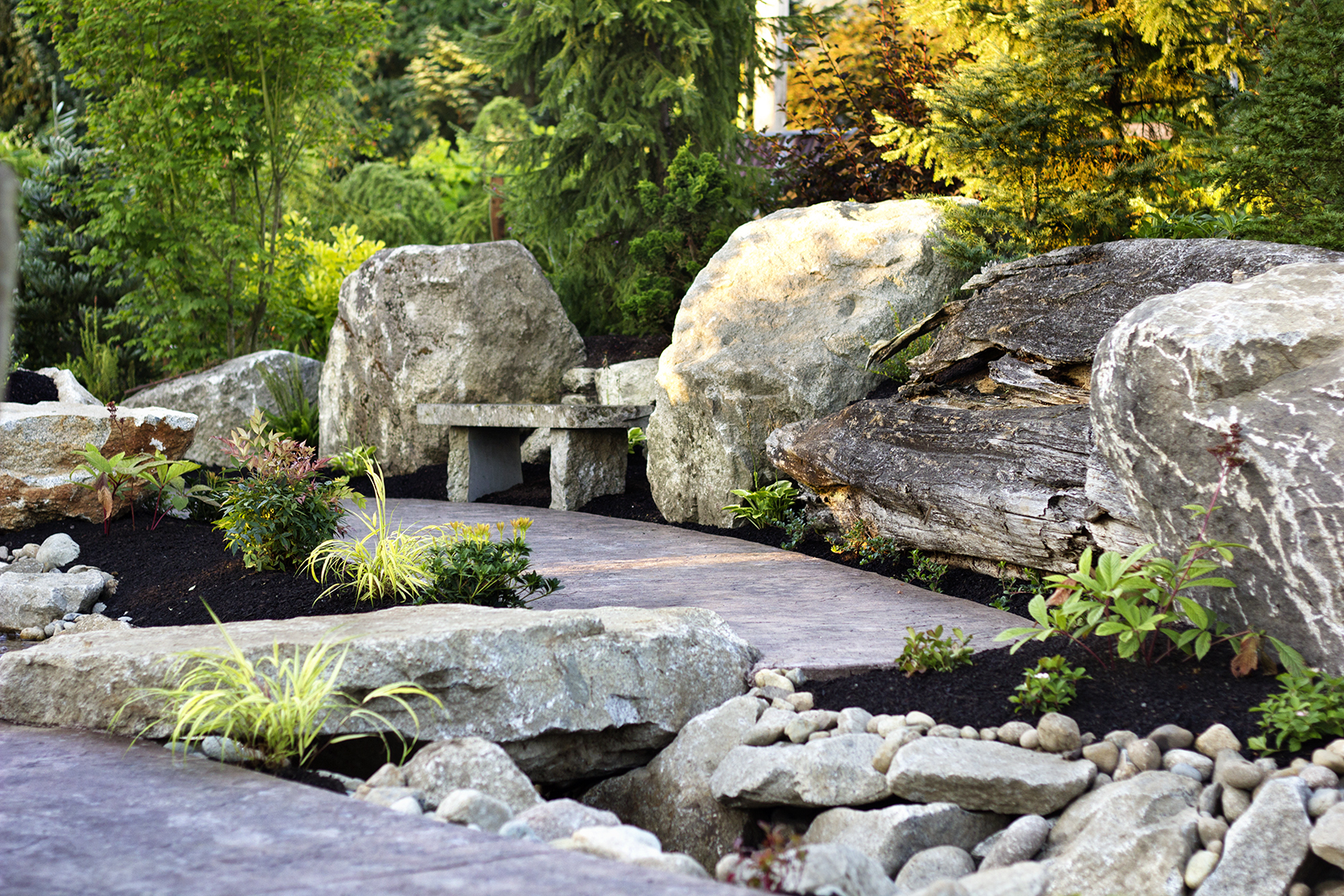 reduced_pc_landscaping_event_area_rock_bridge_water_feature.jpg