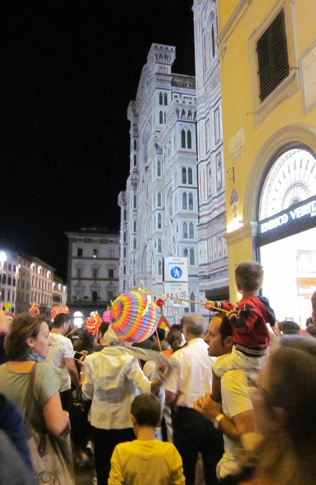 Walking in the annual Rificolona Lantern Festival procession.