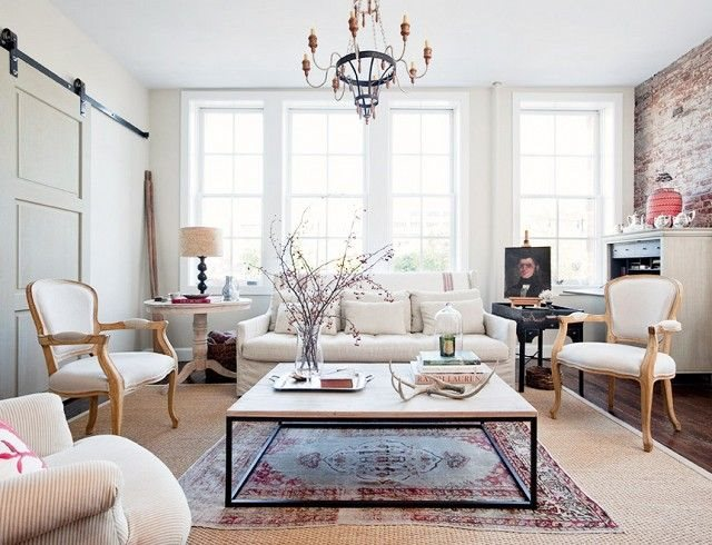 Sea grass rugs, iron coffee tables, and natural wood tones all work beautifully with white walls.