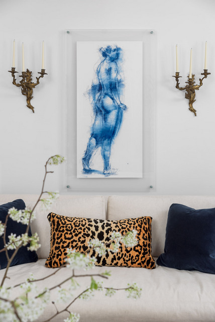 Take for instance, this Chattanooga client's living room. We combined these ornate Rococo candle sconces from her collection with a modern drawing that we put in a clean lined glass frame. Opposites truly attract!