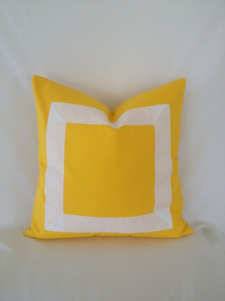 Here's a plain cotton pillow that's been accented with white ribbon trim. I love that it's so simple in design but it stands out as a bold accent.