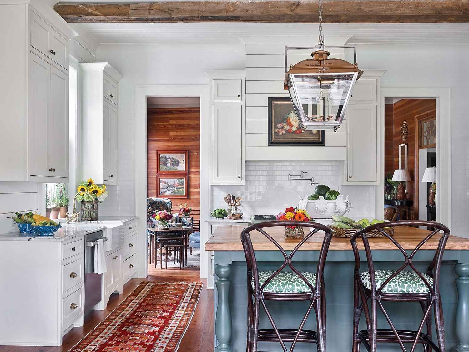 How about this kitchen as Farmhouse inspiration . There's a little shiplap, a simple vase of sunflowers, and a framed vintage still life to suggest farmhouse style without being trite or kitschy.
