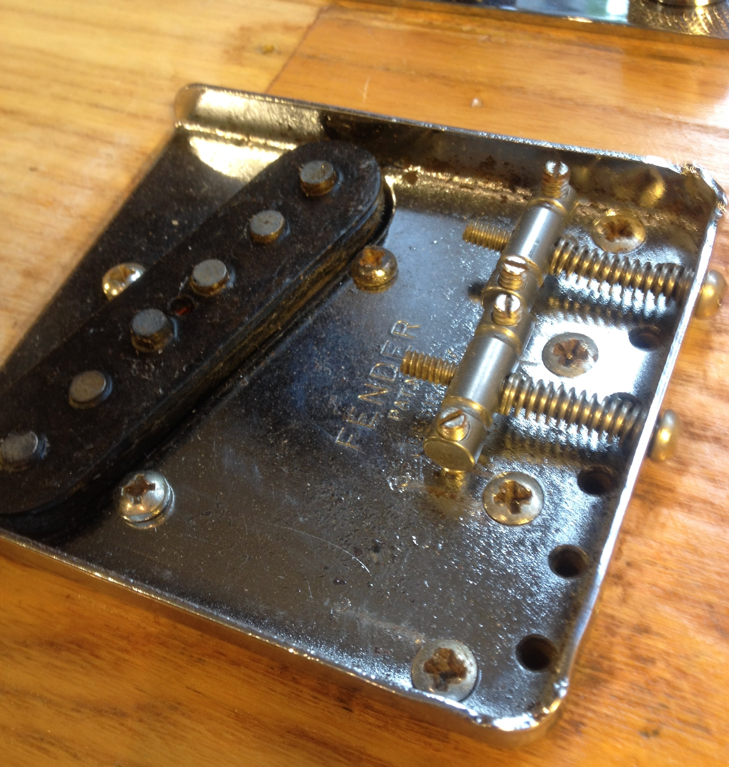 Fender Telecaster from 1973 with a common issue; a chewed height adjuster on the bridge. Cleared the remains away snd now you could hardly tell there was ever a problem.