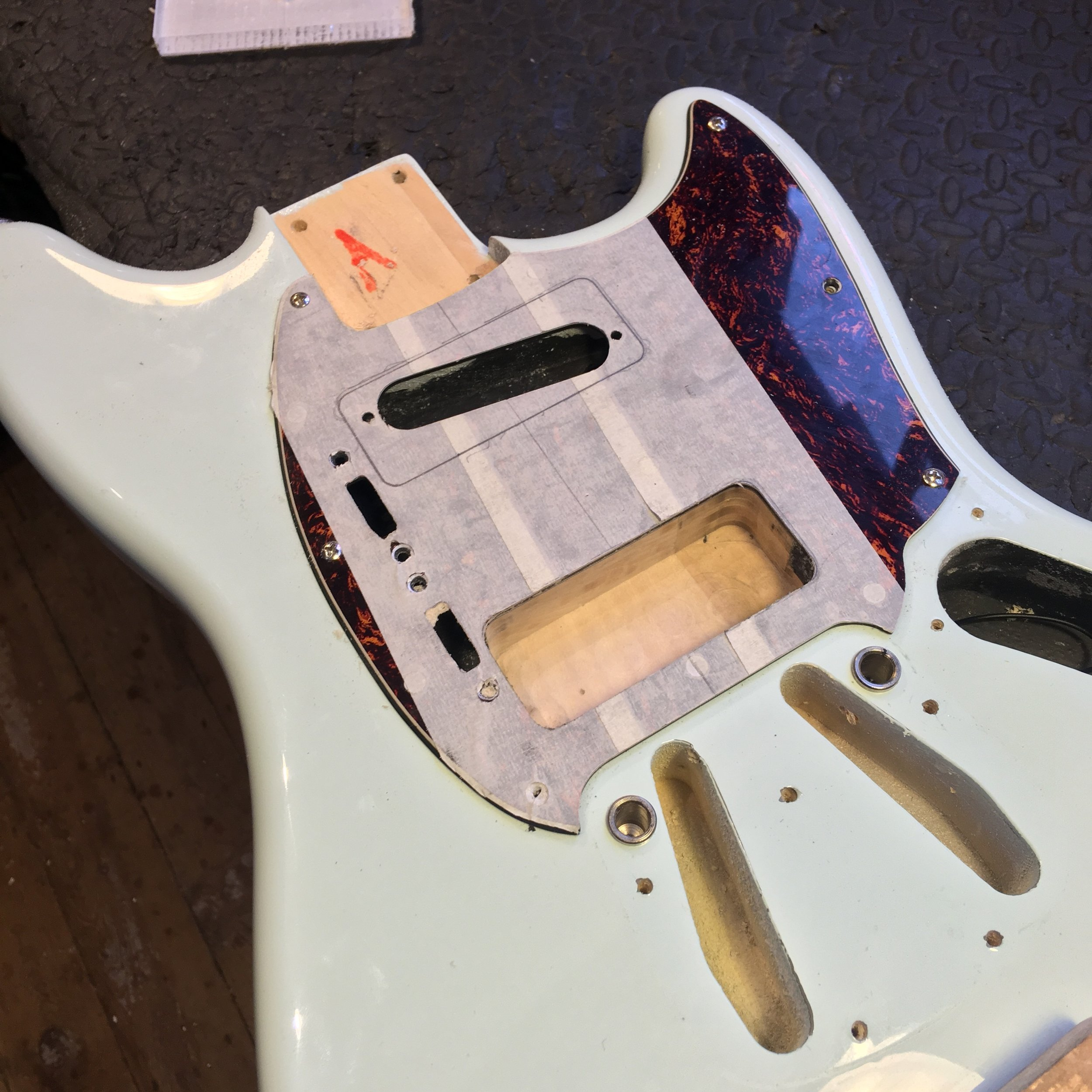 Squier Mustang that's had some major customisation already comes in to have 2 Seymour Duncan P-90's routed and fit. Click for more!