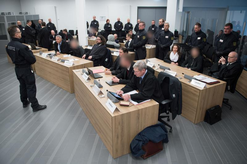 "Defendants of the the far-right group ""Gruppe Freital"" wait for their verdict in a courtroom in Dresden, Germany, March 7, 2018. © 2018 Reuters"