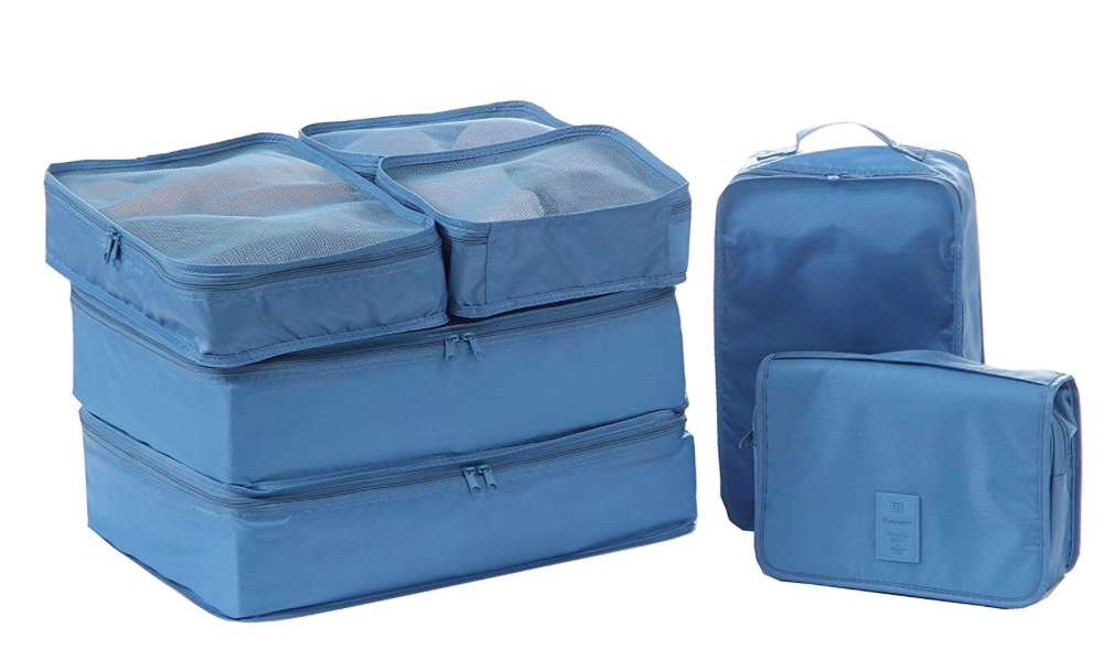 Travel Cubes - These flexible containers making packing for a trip so easy. Everything is contained in neat packages in your suitcase or travel bag. They have mesh ventilation in some of them so clothes breathe. If you wanted you could buy different colours for different family members and know instantly which is which! Grab them or similar here