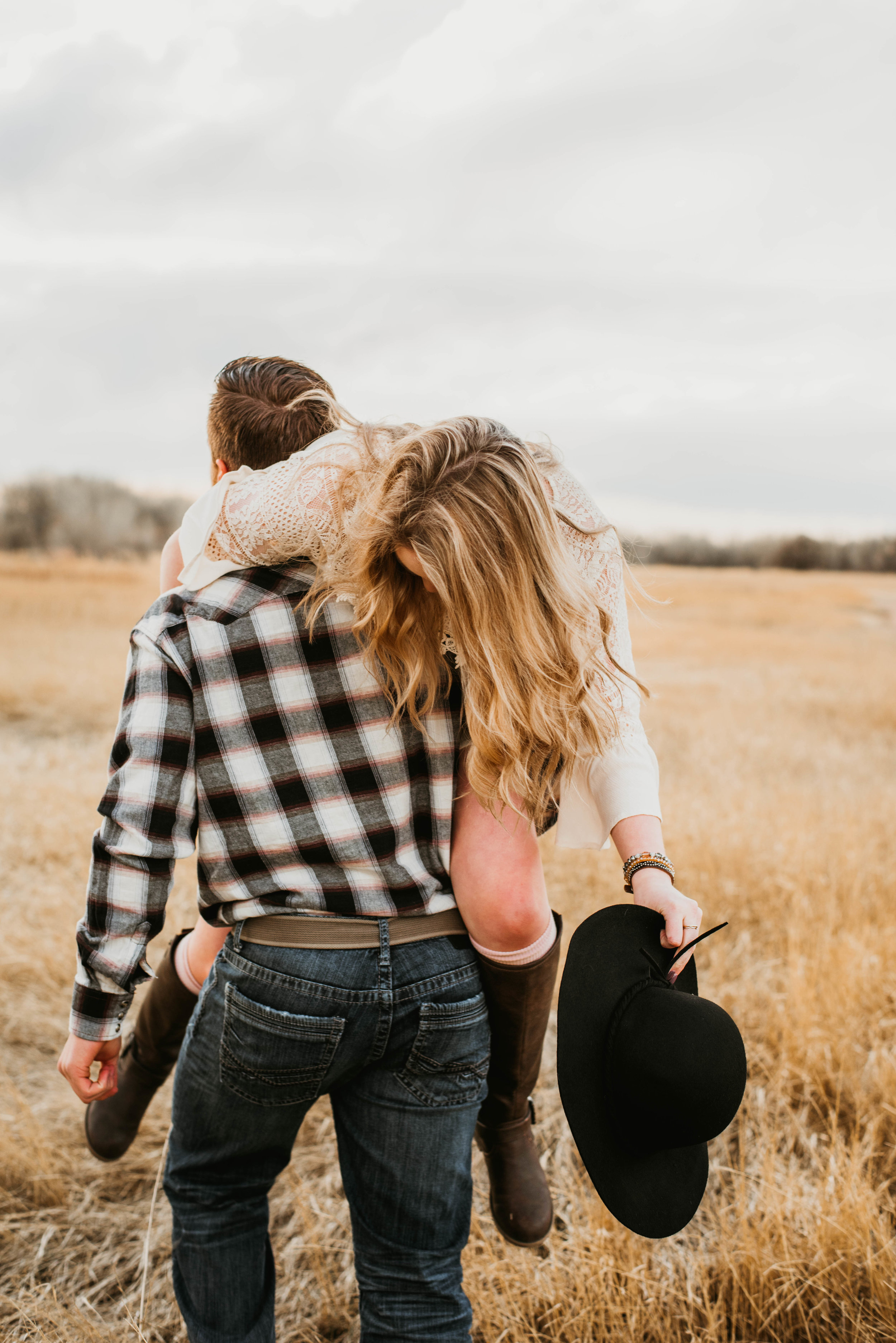 Miss. Miller's Photography | Colorado couples photographer | dirty boots and messy hair presets | Colorado wedding photographer | Couple photo shoot ideas | couples photography ideas | candid couples photo ideas | couples outfit idea for photos