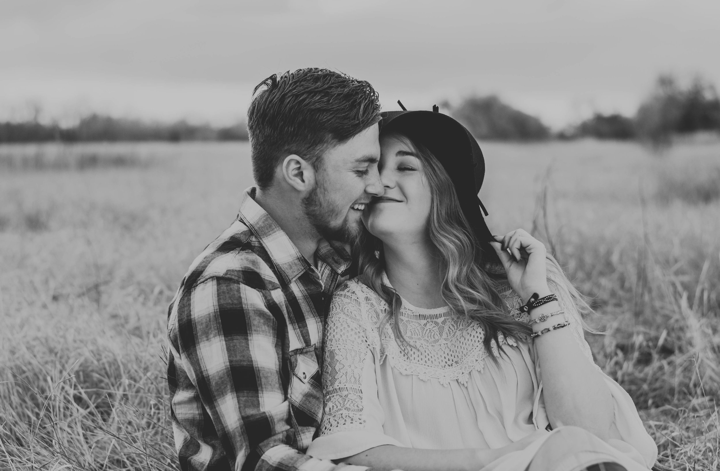 Miss. Miller's Photography | Colorado couples photographer | Colorado elopement photographer | Colorado wedding photographer | sitting down poses for couples | sitting down engagement photos | candid engagement photos | fun engagement photo ideas