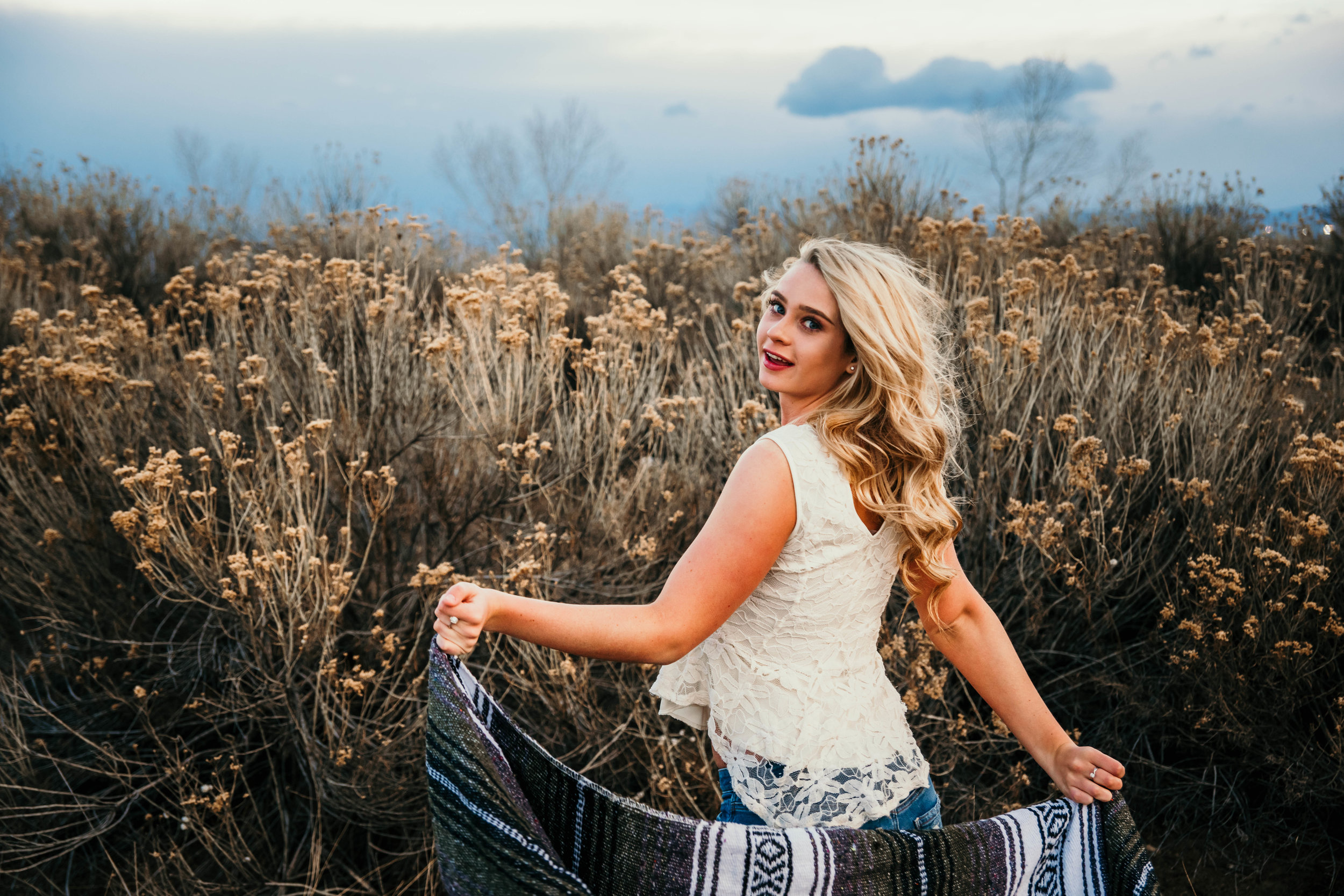 Miss. Miller's Photography | Senior Photo inspo | Colorado senior | Colorado girl | Colorado senior photographer | southwestern blanket in photos | photo shoot with blanket | blonde hair ideas