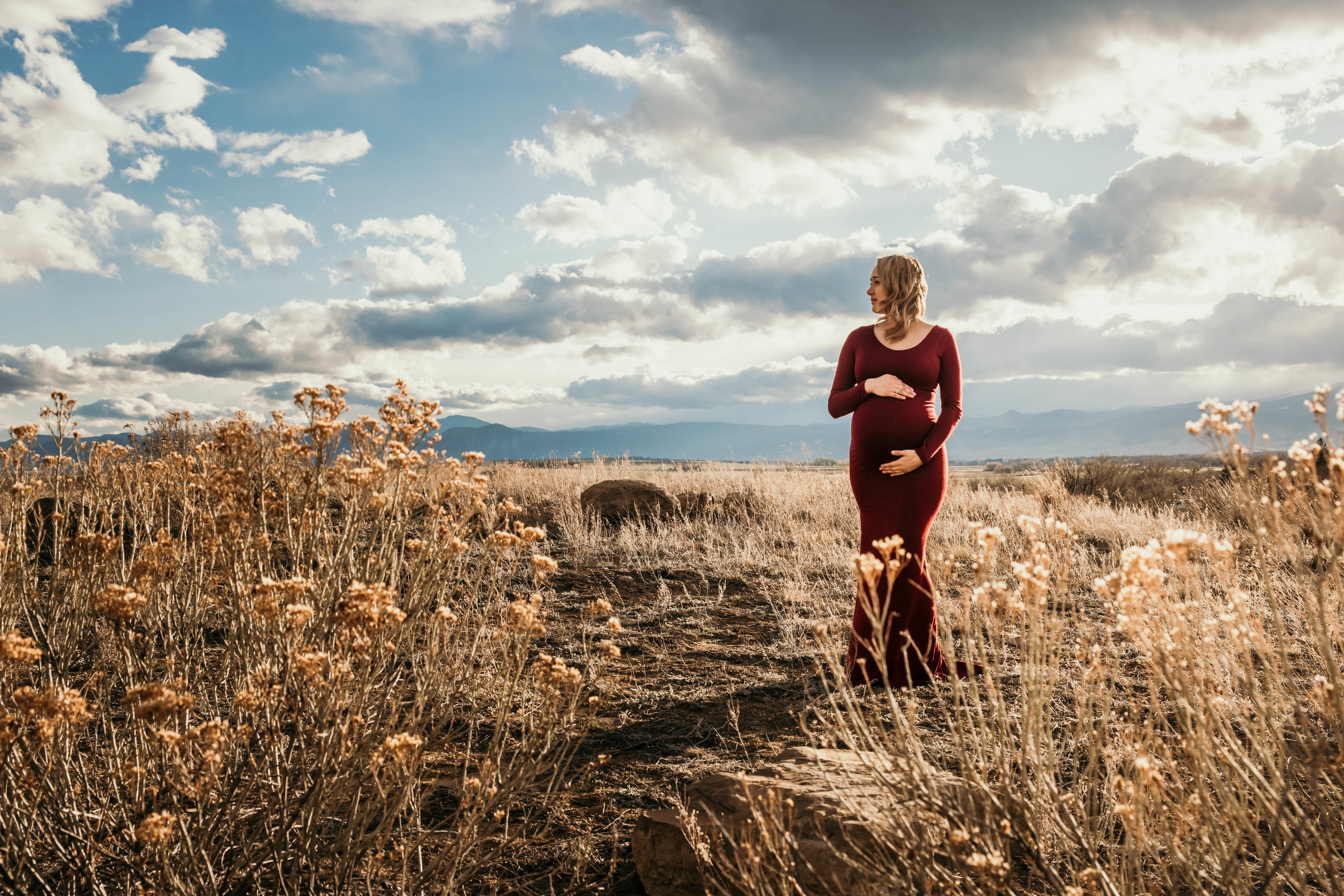 Miss. Miller's Photography | Colorado Photographer | Colorado maternity session | maternity session inspo | maternity photo poses | maternity dresses | maternity outfit ideas | rocky mountain | Photo ideas for maternity | birth announcement | Colorado skies | dirty boots and messy hair