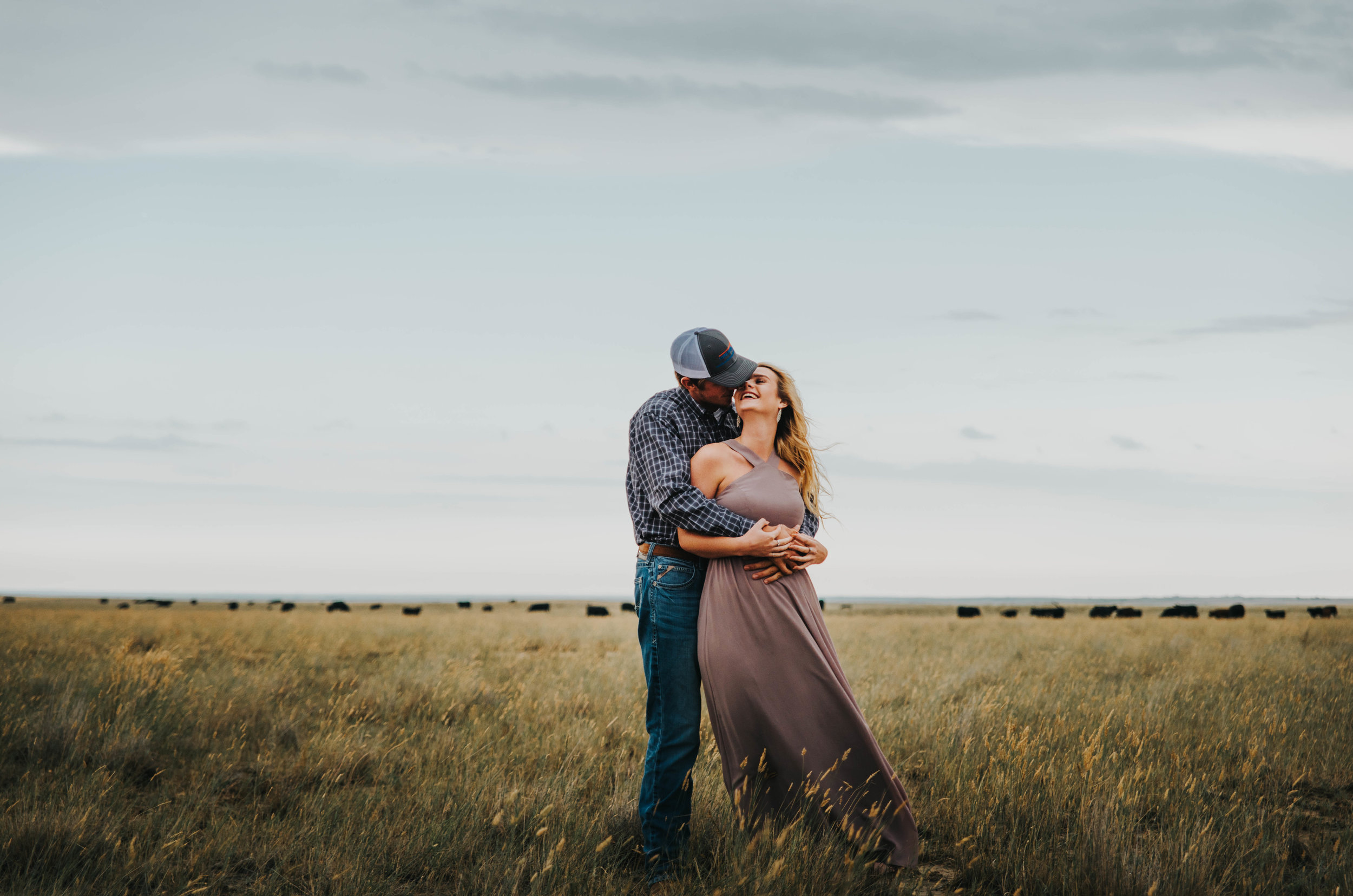 Miss. Miller's Photography | Colorado Wedding Photographer | Buckskin Bride | Western Engagement Photos | Country Engagement Photos | Country couples poses | Colorado Photographer | Looks Like Film | LuLus dresses | Ariat Jeans | Western Couple | Country Couple | Couples Photos | Engagement Inspiration