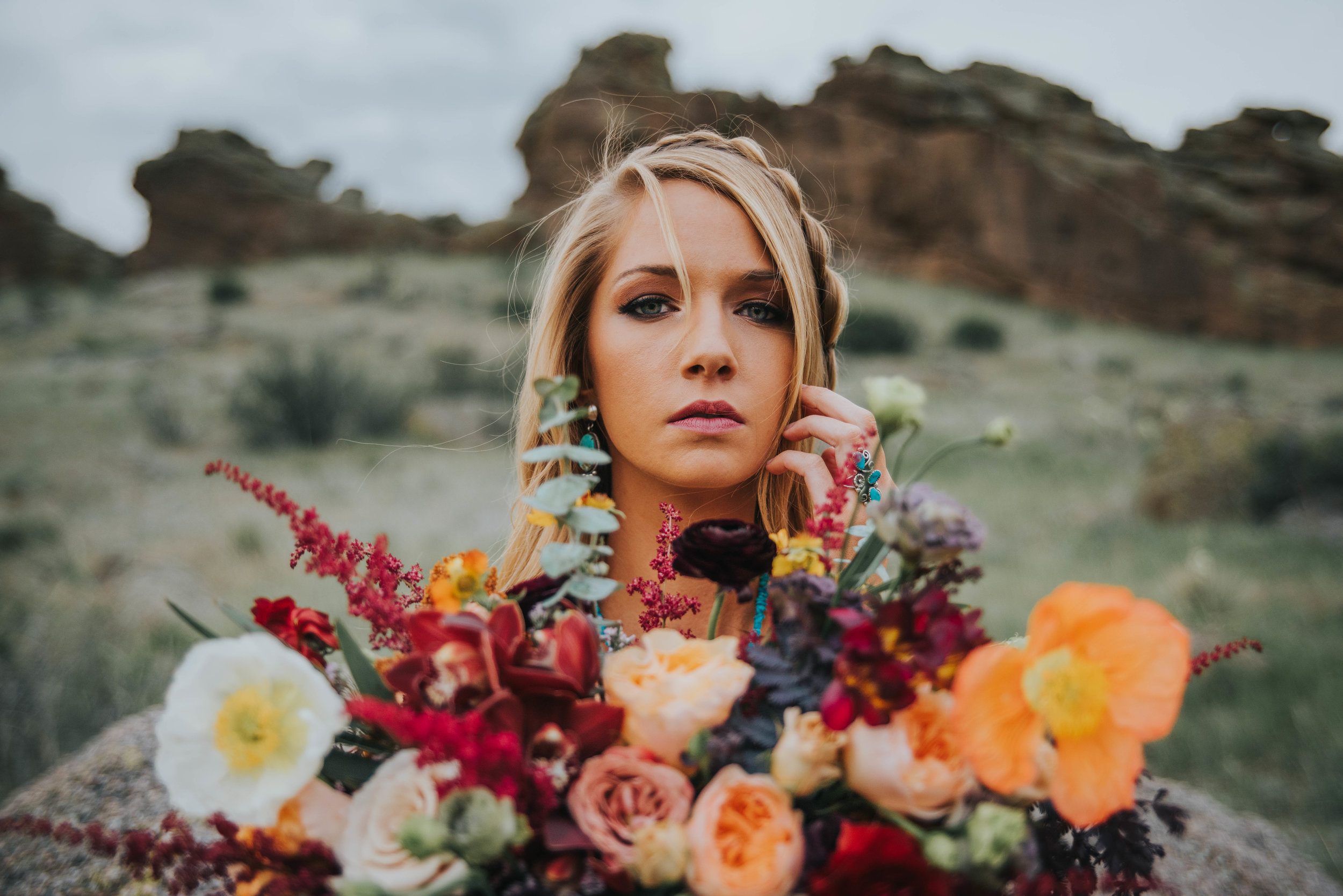 """Early summer floral arrangement by Palmer Flowers Loveland. Notice how the colors and flower types """"fit"""" the setting of our bride? They do not look out of place? We looked for colors that would enhance our background and setting, and not clash with it!"""