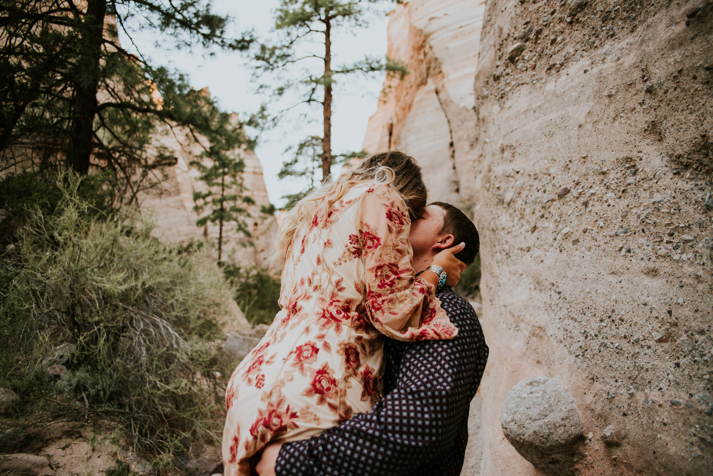 Miss. Miller's Photography | New Mexico Wedding Photographer | Colorado Wedding Photographer | Red Floral Dress | Desert Engagement Photos | Engagement Photo Outfits | Engagement Photos Country | Engagement Photo Ideas |