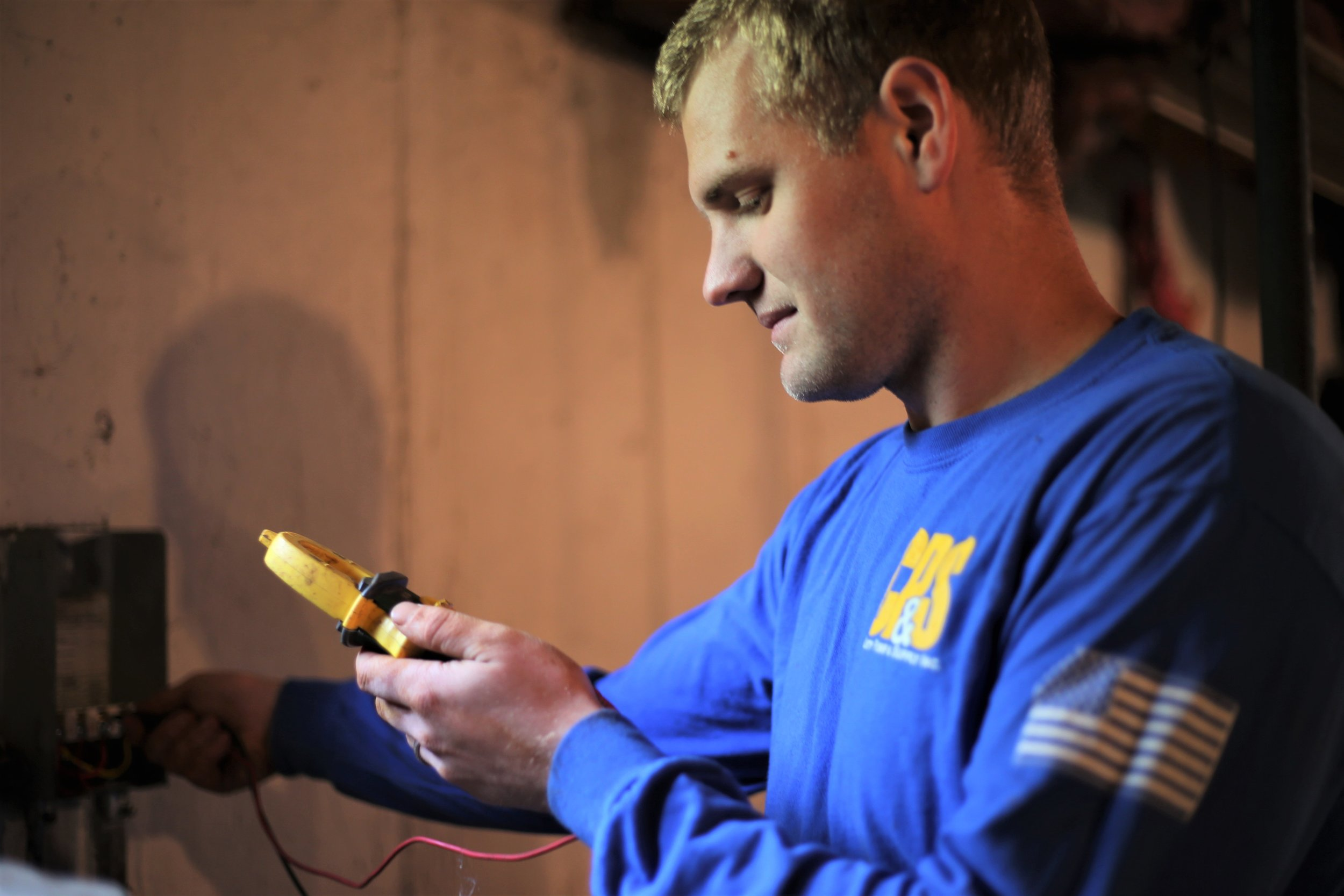 Doug inspects the power during a service call.