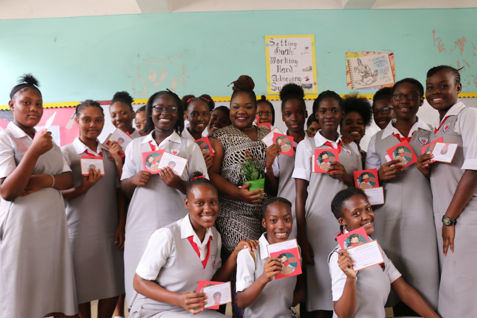 Dania Beckford (centre), entrepreneur and director of entertainment at the Ministry of Culture, Gender, Entertainment and Sports shares a photo-op with grade 9 students at the Young Career Women Day on April 28, 2017 at The Queen's School. Along with the words of encouragement, the ladies received Hope Elliott Scholarship promotional cards and Sean Paul CDs.