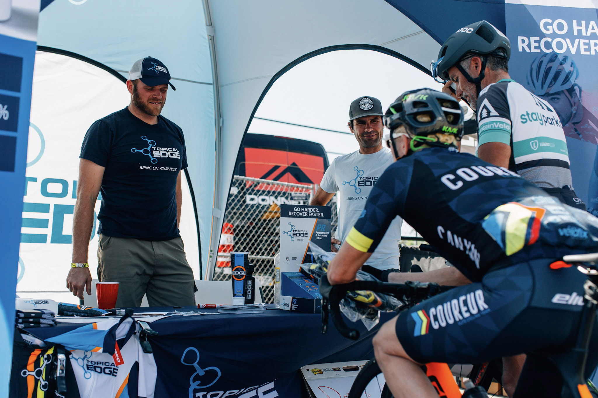 Neil, at the Tropical Edge tent advising a local Coureur rider, is thinking he really should have picked up one of those Gravelstoke hats over at the GUP tent.