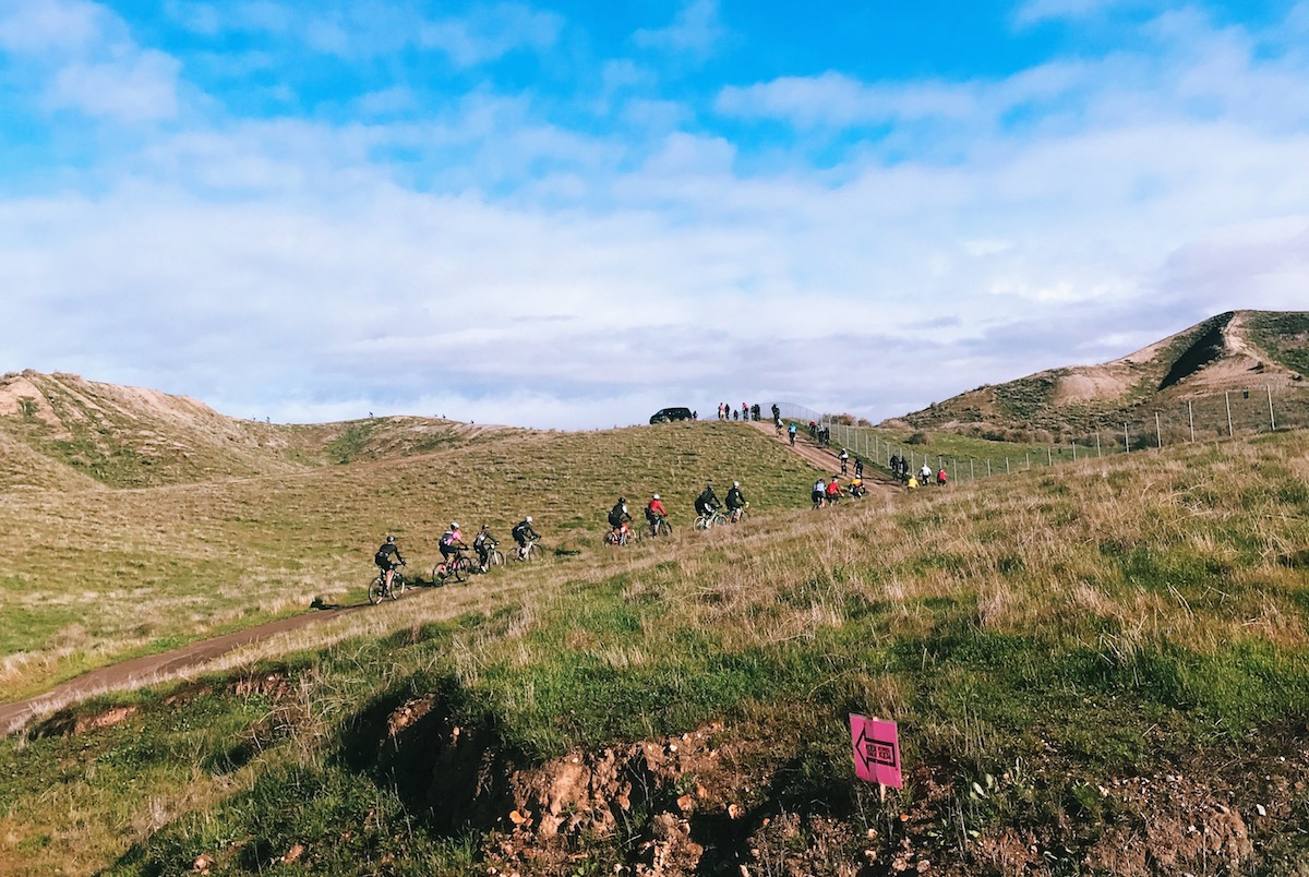 A string of participants take on the first dirt climb of the day