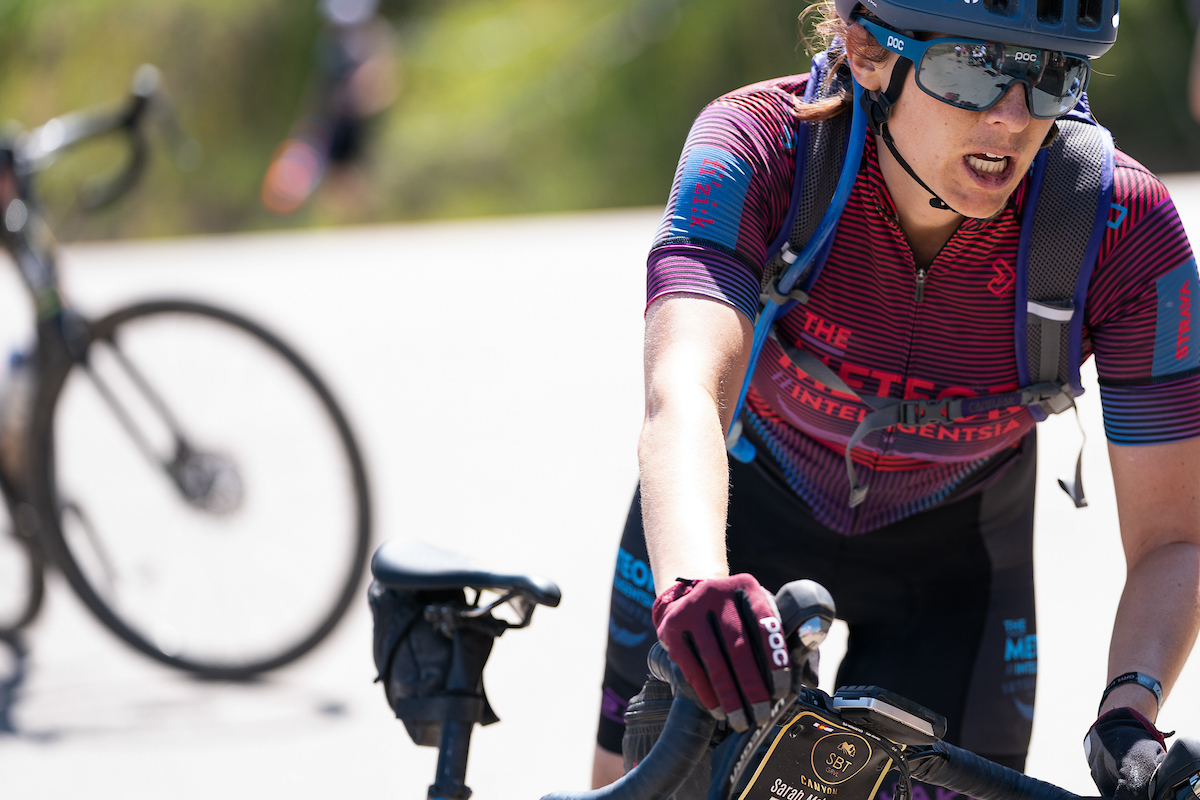 Sarah Moloney of The Meteor // Intelligentsia coming in hot at an aid station late in the race. PC: Dane Cronin