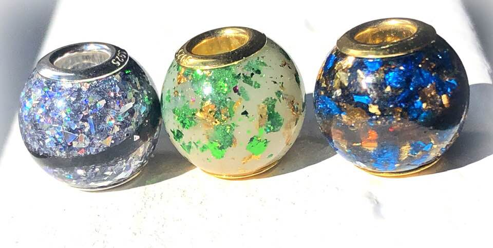 Pictured left to right: Silver holographic flakies, Emerald and Golden metallic flakies, and sapphire and golden flakies.