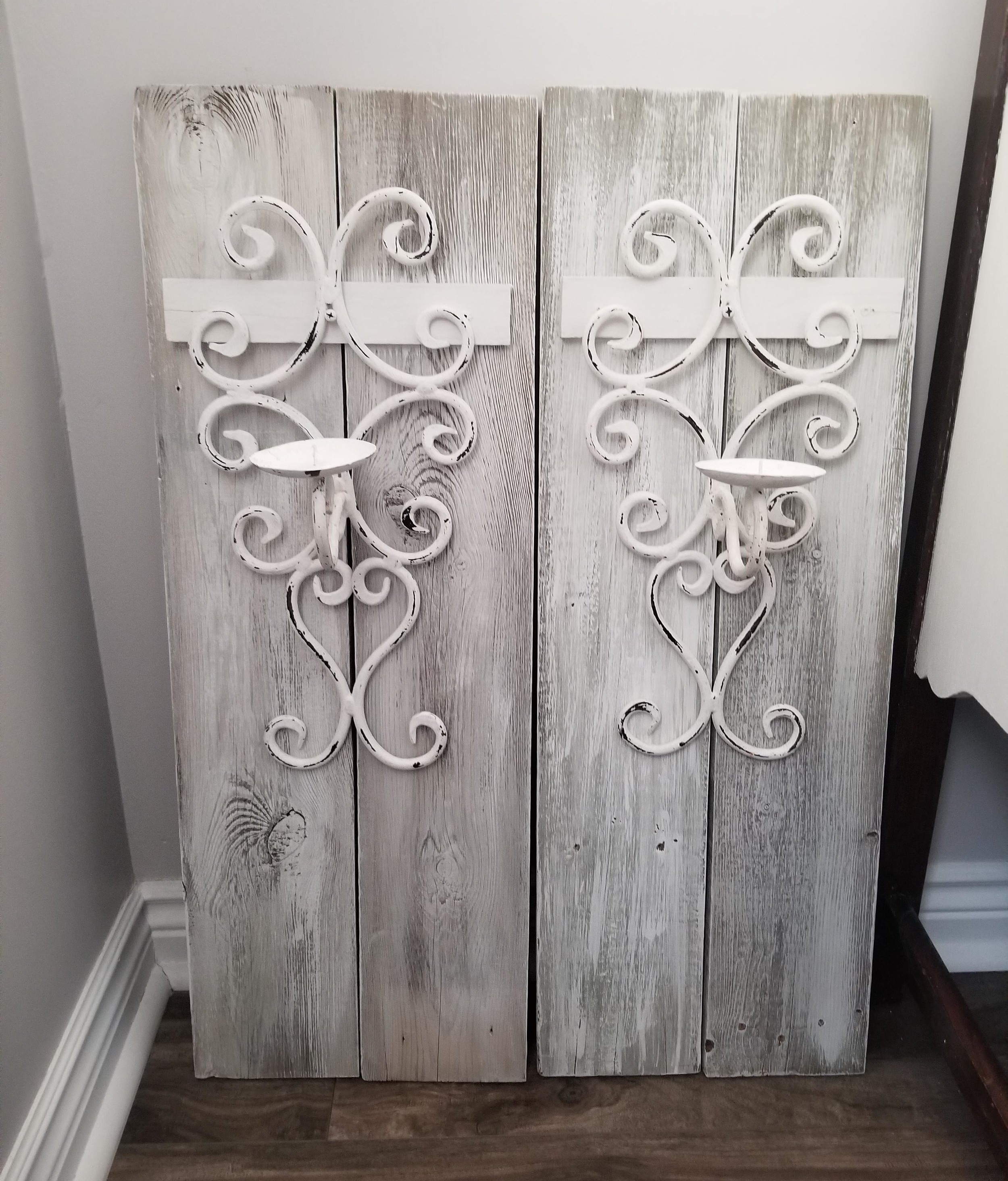 "How amazing did these wall sconces turn out. Btw to make these beautiful pieces old fence wood was used that had come down in our backyard during a wind storm that we had a few months earlier. Just another way that I like to show you guys the beautiful things that we can create when we think outside the box. Btw these beauties sold earlier this week. Goodbye chippy wrought iron candle holders. As Nelson would say ""On to the next one. """