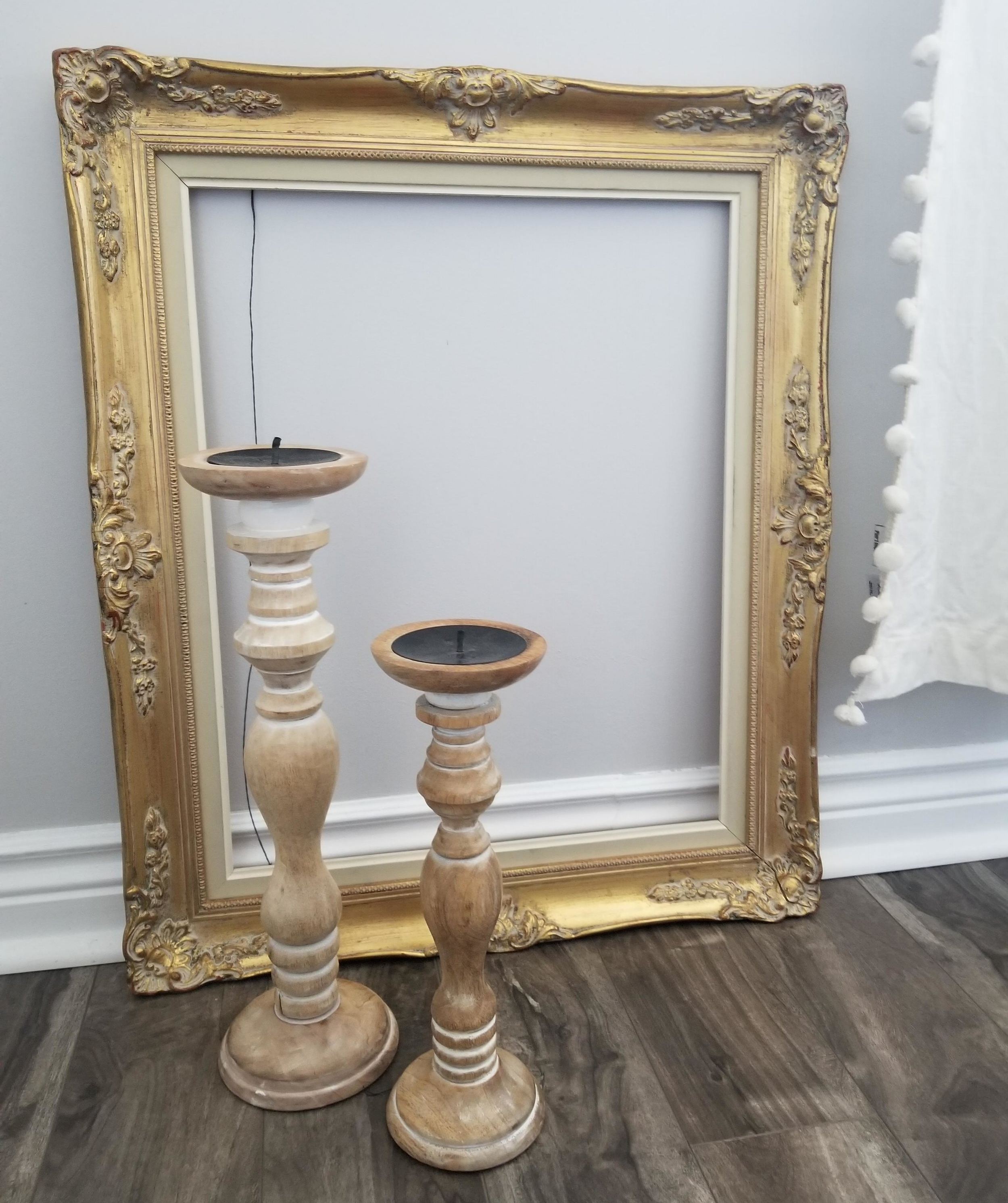 A gold vintage frame I found for $7, totally fell in love with it the minute that I saw it. Also these two candle holders for $3 each which such a steal. Love the rustic look of these.