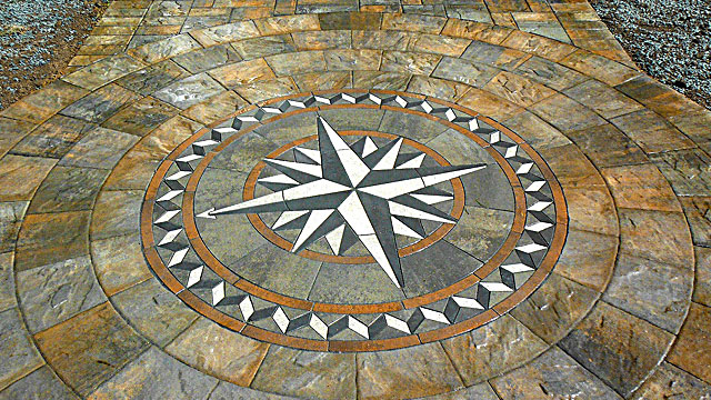 Paver Art - Create a stunning focal point for your walkway or patio with a beautiful paver art centerpiece.