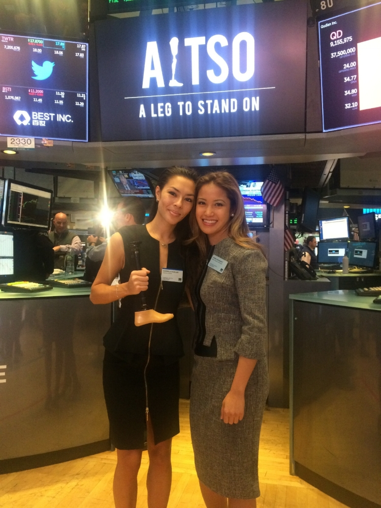 Donna at the NYSE is wearing the  Tory Blazer  and a  Tweed Pencil Skirt