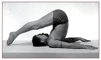 Joseph Pilates performing the Rollover.