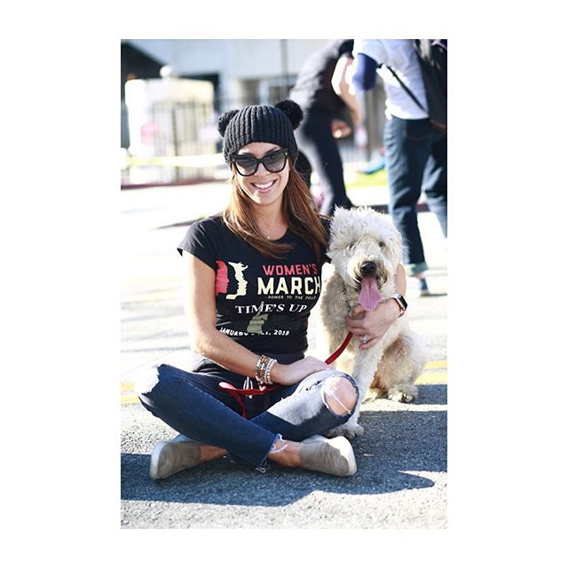 """LOS ANGELES, CALIF. """"I happened to be hear and staying down the street. I have been super active in women's rights. When you get a big group together you can feel the energy and it makes you want to cry. You can feel the love being among all these different people,"""" Cera Norton said. She sits with her dog Bunsen at the Jan. 20, 2018 Women's March.• #womenof #womensmarch #womenanddogs #dogsofinstagram #lovepeople #goodenergy #grandcentralmarket #streetsitting #freelove #womensmarch2018 #california #losangeles #pershingsquare #life"""