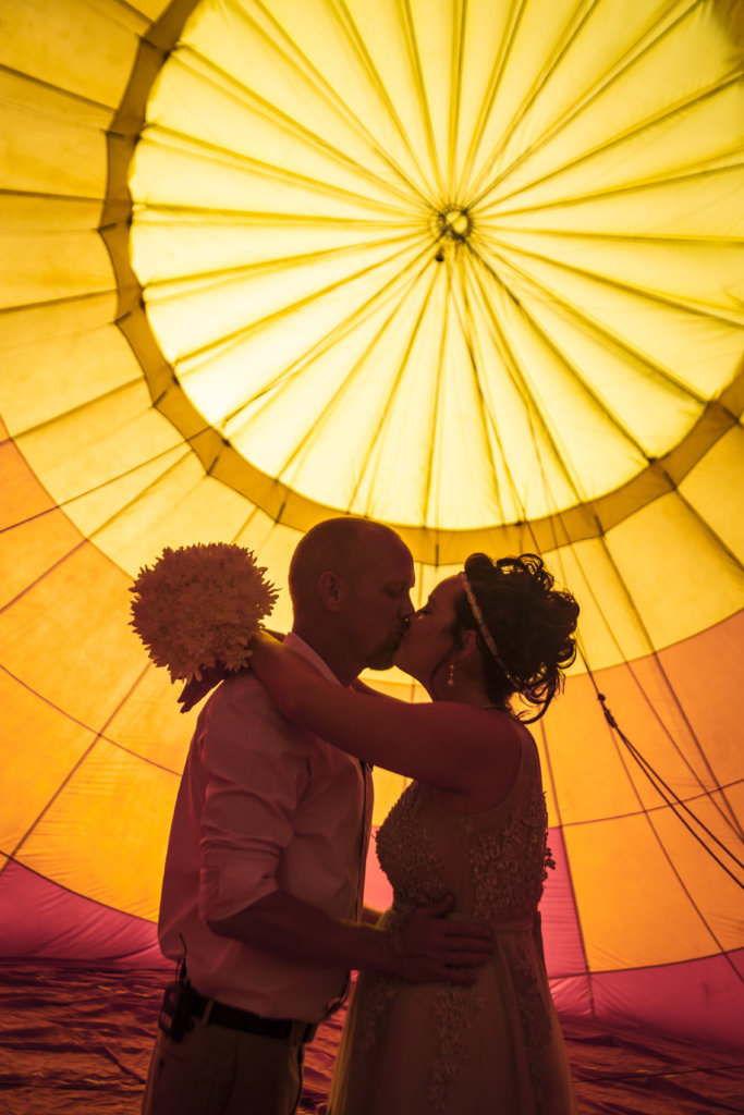 LOVE IS IN THE AIR BALLOONING  -  TRYING TO FIGURE OUT  THE BEST WAY TO HAVE A SMALL WEDDING?  WANT TO ELOPE IN VEGAS?  WHY NOT GET MARRIED ON A HOT AIR BALLOON?  THE BASKET IS HANDICAP-ACCESSIBLE SO YOU DON'T HAVE TO HOP OVER THE SIDE IN YOUR WEDDING DRESS! PLUS YOU GET THE WHOLE THING DOCUMENTED FROM ARRIVAL TO LANDING BY ME!
