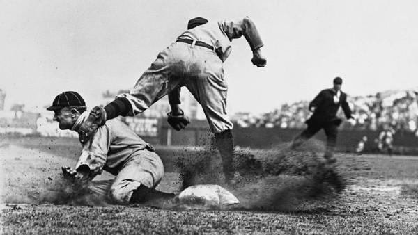 Ty Cobb    sliding into third base   , 1910.