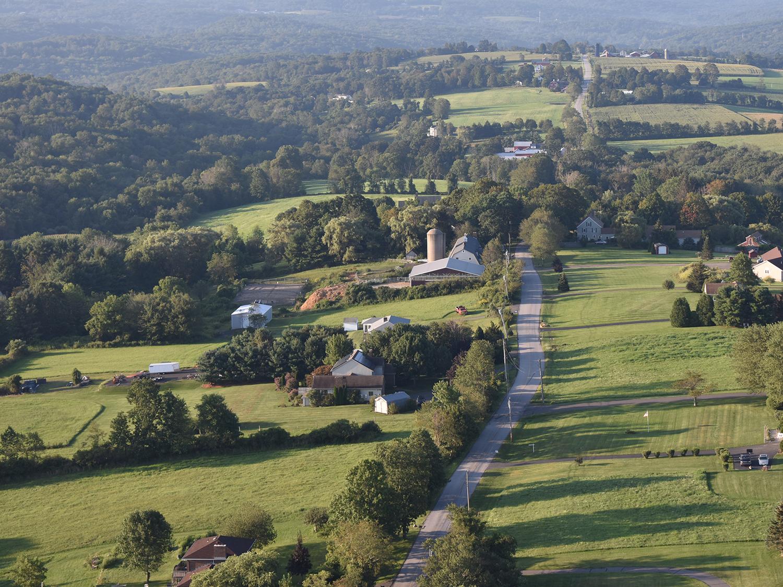 hot_air_balloon_country_road_aerial_view.jpg