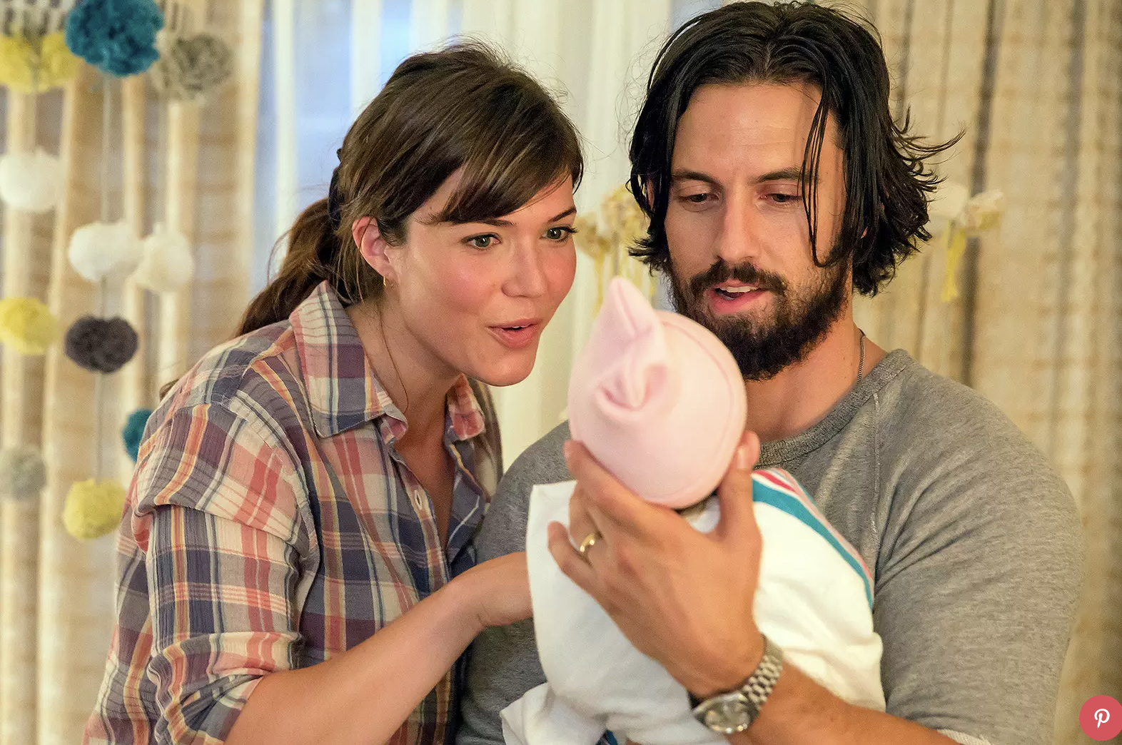 This is how I assumed Michelle and Luke looked when they got to see their baby...they looked exactly like Mandy Moore and Milo Ventimiglia in the show This is Us.
